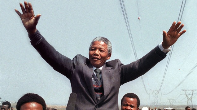 Anti-apartheid leader and member of the African National Congress (ANC) Nelson Mandela salutes supporters while addressing on September 05, 1990 in Tokoza a crowd of residents from the Phola park squatter camp during his tour of townships. Nelson Mandela spent 27 years as a political prisoner in South Africa before becoming the country's first black president IN 1994. Mandela was a leading member of the African National Congress (ANC), which opposed South Africa's white minority government and its policy of racial separation, known as apartheid. AFP PHOTO TREVOR SAMSON (Photo credit should read TREVOR SAMSON/AFP/Getty Images)