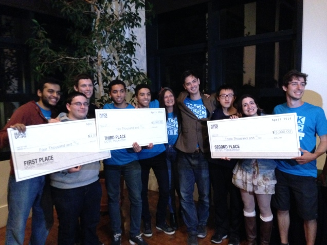 The top 3 Finalists holding their winning checks, from left to right Bubblecoup, Top 5 and Project Slug
